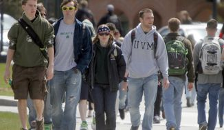 **FILE** Students walk across campus April 30, 2012, at the University of Vermont in Burlington, Vt. (Associated Press)