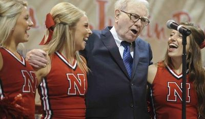 Warren Buffett, chairman and CEO of Berkshire Hathaway, sings with University of Nebraska cheerleaders prior to the company's annual shareholders meeting in Omaha, Neb., Saturday, May 5, 2012. (Associated Press)