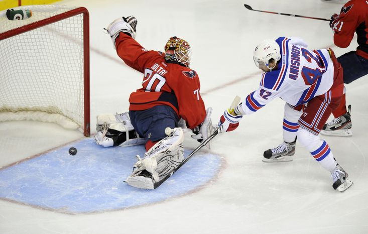 New York Rangers center Artem Anisimov (42), of Russia, shoots the puck past Washington Capitals goalie Braden Holtby (70) for a goal during the second period of Game 4 of an NHL hockey Stanley Cup second-round playoff series, Saturday, May 5, 2012, in Washington. (AP Photo/Nick Wass)