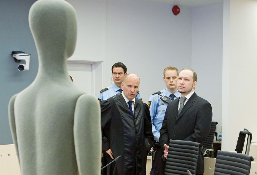 Anders Behring Breivik (above right) and defense attorney Geir Lippestad look across the courtroom Friday at a life-size display dummy used to illustrate how and where the different victims at Utoeya Island were hit in the mass shooting July 22, 2011, for which Mr. Breivik is on trial in Oslo. He speaks with his other defense attorney Vibeke Hein Baera (top). The far-right fanatic, who has admitted to the massacre and a bombing in Oslo the same day that killed a total of 77, listened impassively Friday as as lawyers for the bereaved read emotional statements and showed pictures from the victims' lives alongside the coroner's autopsy reports. (NTB Scanpix via Associated Press)