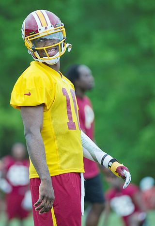 Robert Griffin III seemed at ease in his new surroundings despite there being twice the amount of media members present than in a normal year. (Barbara L. Salisbury/The Washington Times)