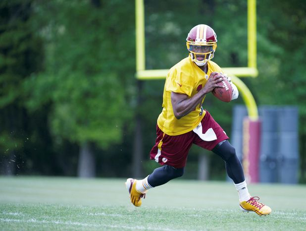 Robert Griffin III showed off his arm strength, but there also were a few reminders during his first weekend of practices that he's still an NFL rookie. (Barbara L. Salisbury/The Washington Times)