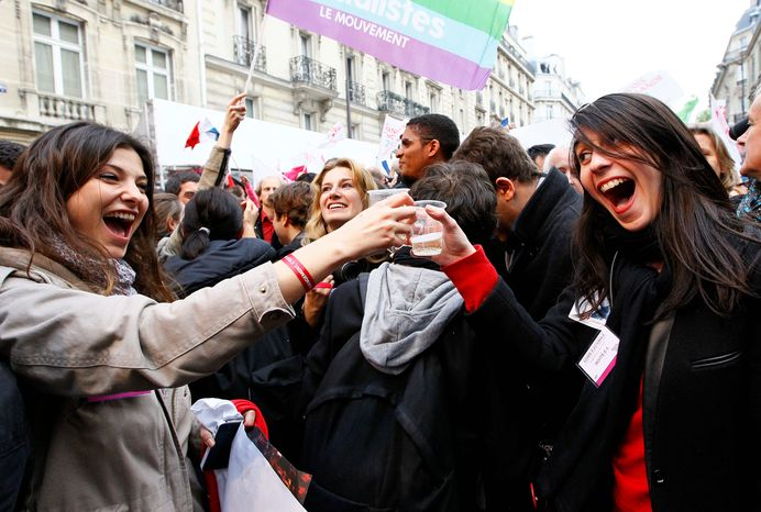 "Supporters of Mr. Hollande celebrate with champagne after results of the second round of the French presidential election were announced Sunday. The party outside Socialist Party headquarters in Paris. ""Austerity can no longer be inevitable,"" Mr. Hollande declared in his victory speech Sunday night, referring to Mr. Sarkozy's push for belt-tightening to fight persistent unemployment and rising national debt. (Associated Press)"