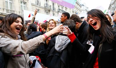 """Supporters of Mr. Hollande celebrate with champagne after results of the second round of the French presidential election were announced Sunday. The party outside Socialist Party headquarters in Paris. """"Austerity can no longer be inevitable,"""" Mr. Hollande declared in his victory speech Sunday night, referring to Mr. Sarkozy's push for belt-tightening to fight persistent unemployment and rising national debt."""