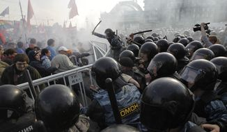 Russian riot police disperse protesters demonstrating against President-elect Vladimir Putin in downtown Moscow on Sunday, May 6, 2012. (AP Photo/Sergey Ponomarev)