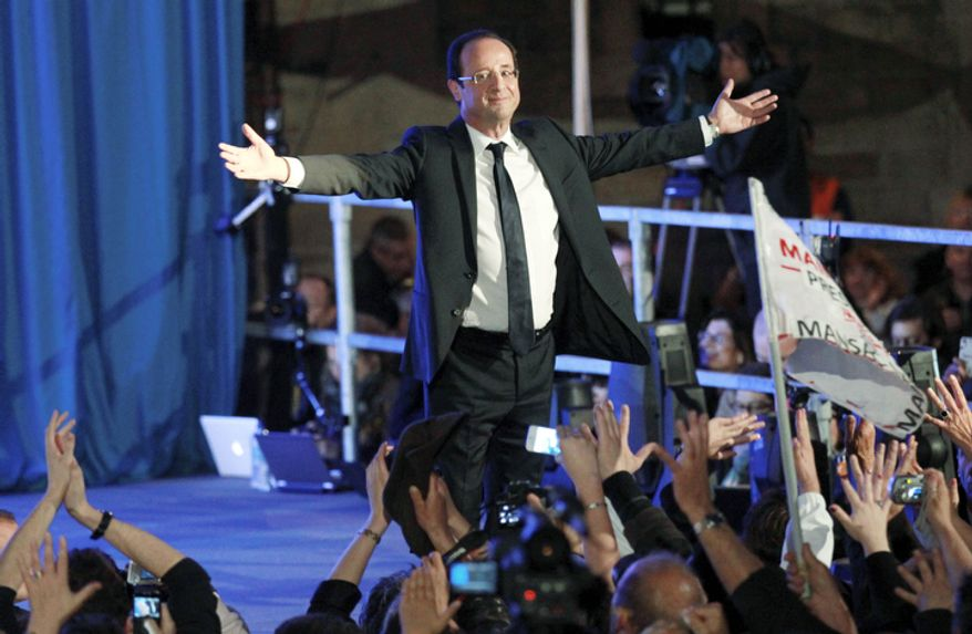 President-elect Francois Hollande waves after delivering his speech in Tulle, central France, Sunday, May 6, 2012.  Francois Hollande defeated Nicolas  Sarkozy on Sunday to become France's next president.  (AP Photo/Bob Edme)