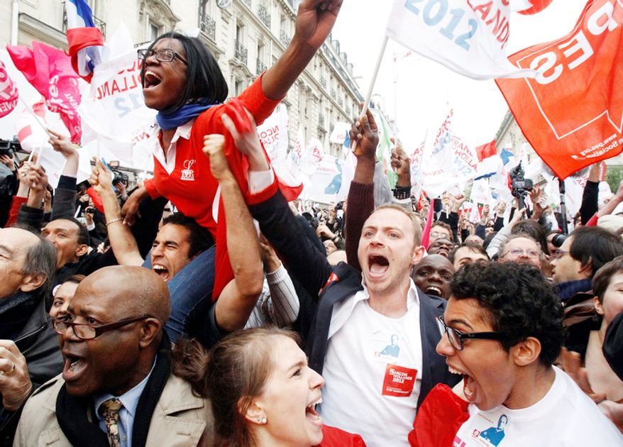 Supporters of Socialist Party candidate for the presidential election Francois Hollande react after the final results show that Hollande won the election.   (AP Photo/Remy de la Mauviniere)