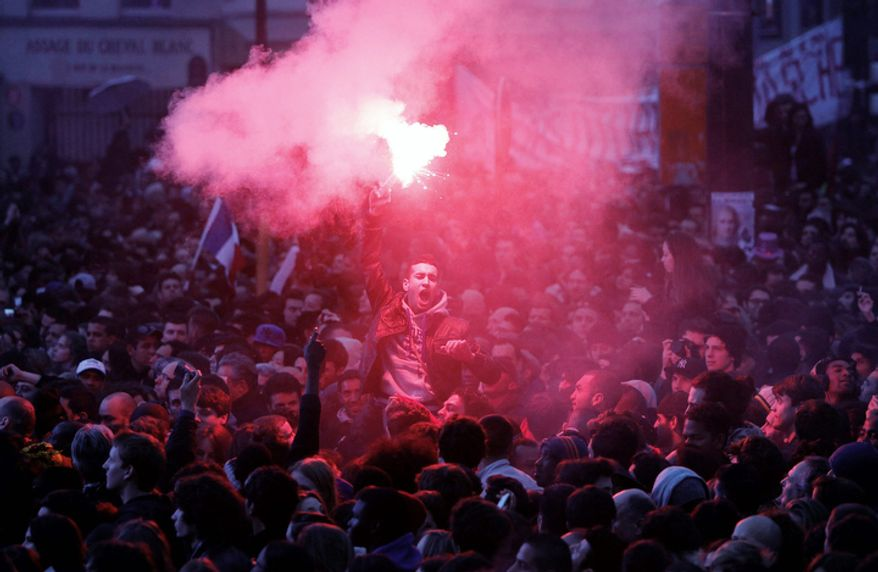 Supporters of president-elect Francois Hollande celebrate after socialist Francois Hollande defeated conservative incumbent Nicolas Sarkozy on Sunday to become France's next president. (AP Photo/Laurent Cipriani)