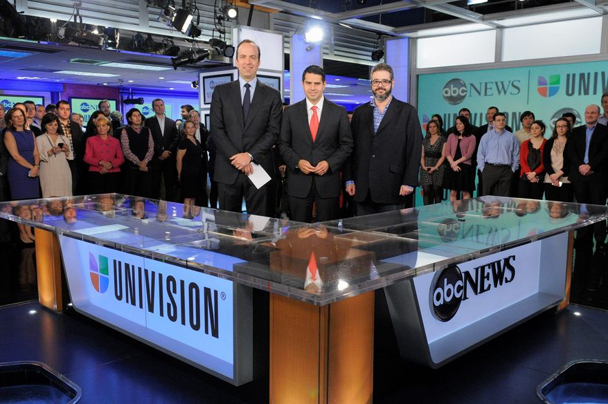 ABC News and Univision announce plans to start and English-language news network aimed at Latinos who prefer to get their news in English. Making the announcement Monday in New York are (from left) ABC News President Ben Sherwood, Univision Networks President Cesar Conde and Univision News President Isaac Lee. (ABC via Associated Press)