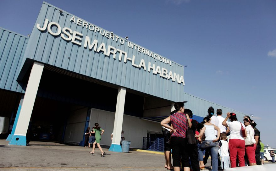 In this Friday, April 3, 2009 file photo, people wait for relatives arriving from the U.S. outside the Jose Marti International Airport in Havana, Cuba. Cuba's government appears on the verge of a momentous decision that could end a half-century of travel restrictions that make it difficult to leave the Communist-run island, even for vacation. (AP Photo/Javier Galeano, File)