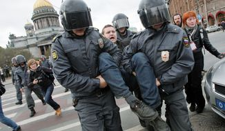 Police detain a demonstrator in St. Petersburg during a protest rally against Mr. Putin's inauguration. (Associated Press)