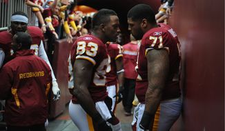 Washington Redskins tight end Fred Davis (83) and offensive tackle Trent Williams (71) get focussed before the Dallas Cowboys game at FedEx Field in Landover, Md., on Sunday, November 20, 2011. (Rod Lamkey Jr./The Washington Times)