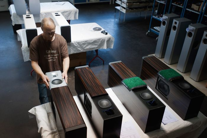 A worker assembles tweeters for speakers at Burmester Audiosysteme in Berlin, which sells top-of-the-line sound systems starting at $4,000 and rising to $460,000. The company is designing exclusive surround-sound systems for Porsche. (Daniel Pilar/Special to The Washington Times)