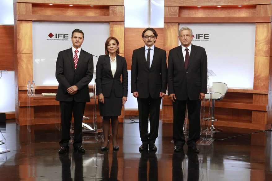 Mexican presidential candidates (from left) Enrique Pena Nieto (Revolutionary Institutional Party [PRI]), Josefina Vazquez Mota (National Action Party [PAN]), Gabriel Quadri (New Alliance Party [PANAL]) and Andres Manuel Lopez Obrador (Democratic Revolution Party and Workers Party [PRD,PT]), pose before the start of the first presidential debate in Mexico City on Sunday, May 6, 2012, in this photo released by Mexico's Federal Electoral Institute (IFE). Mexico's presidential election will be held July 1. (AP Photo/IFE)