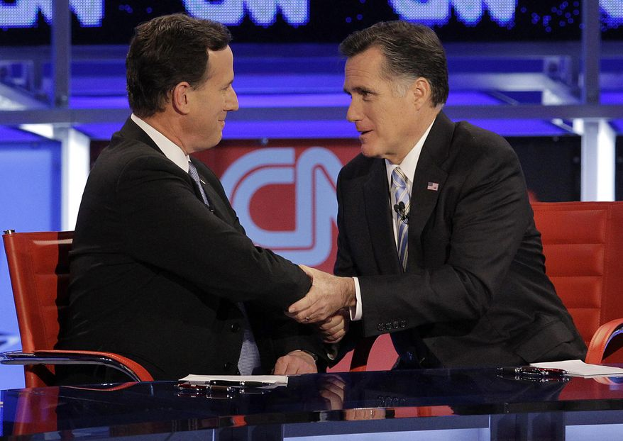 """** FILE ** In this Feb. 22, 2012, photo Republican presidential candidate and former Massachusetts Gov. Mitt Romney, right, talks with fellow candidate, former Pennsylvania Sen. Rick Santorum, after a presidential debate in Arizona. On Monday night, May 7, 2012, Santorum endorsed Romney, saying """"above all else"""" they agree that Obama must be defeated. (AP Photo/Jae C. Hong, File)"""