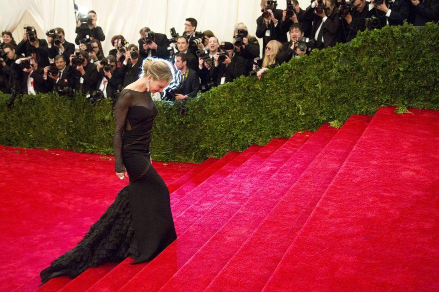 Renee Zellweger arrives May 7, 2012, at the Metropolitan Museum of Art Costume Institute in New York for a gala benefit celebrating Elsa Schiaparelli and Miuccia Prada. (Associated Press)