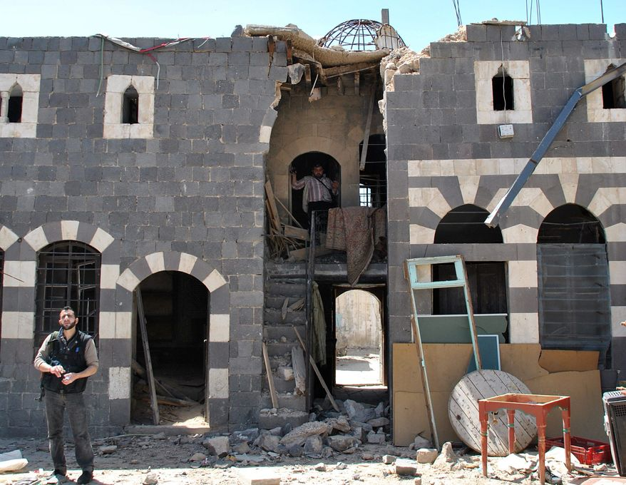 This historic house in the al-Hamidiya neighborhood of the old city Homs was shelled by Syrian security forces. The chaos from Syria's yearlong revolt is destroying some of the country's most important archaeological sites and old buildings. Horrified experts warn that some of the Middle East's most precious sites are at risk of destruction and looting. (Associated Press)