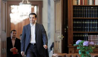 """This is a historic moment for the Left and the popular movement and a great responsibility for me,"" says Alexis Tsipras, leader of Greece's Radical Left Coalition party that won 16.8 percent of the vote in Sunday's national election. (Associated Press)"