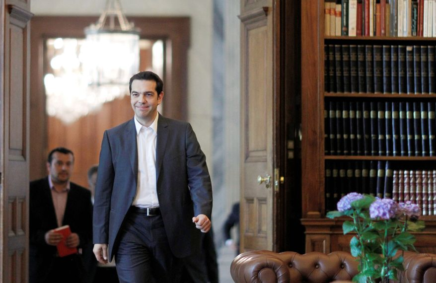 """""""This is a historic moment for the Left and the popular movement and a great responsibility for me,"""" says Alexis Tsipras, leader of Greece's Radical Left Coalition party that won 16.8 percent of the vote in Sunday's national election. (Associated Press)"""
