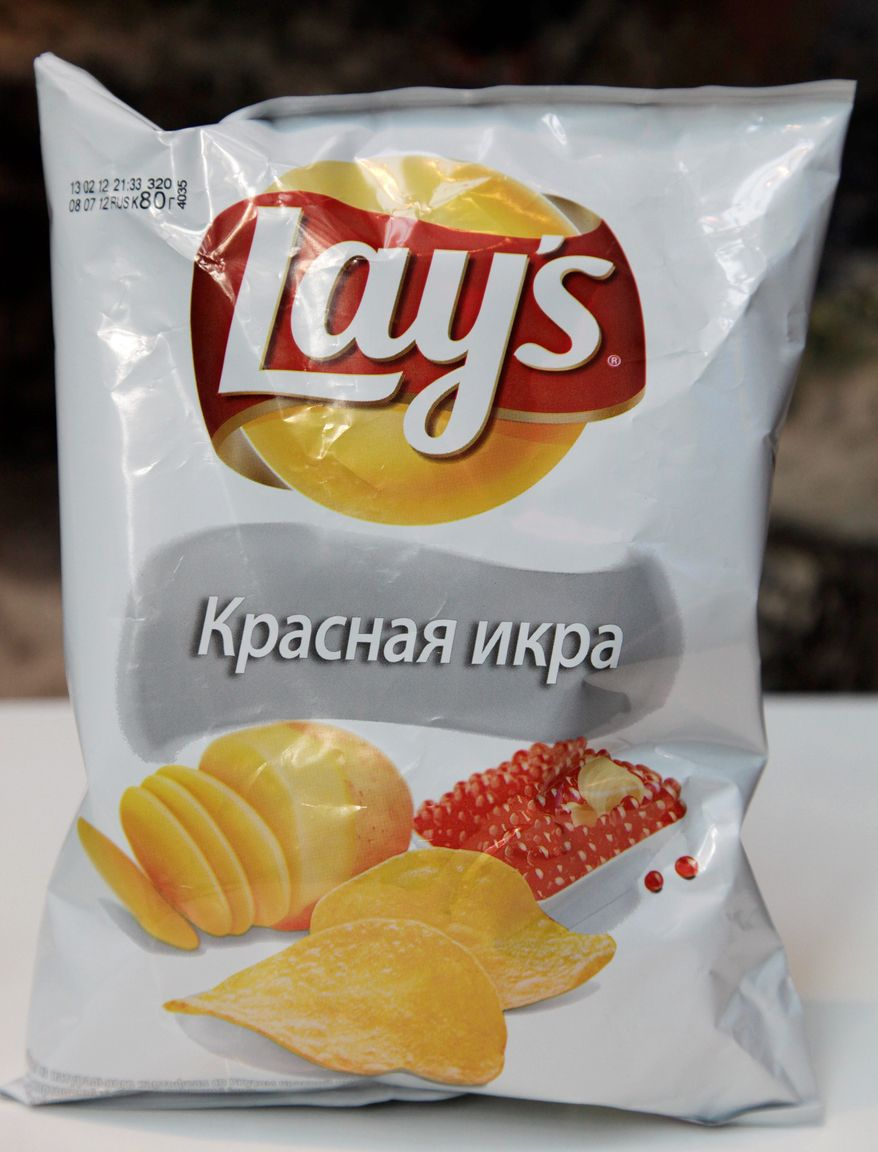 Lays' caviar-flavored potato chips are popular in Moscow, where they are competing with a Soviet-era snack of stale bread slathered in oil and baked to a crisp. (Associated Press)