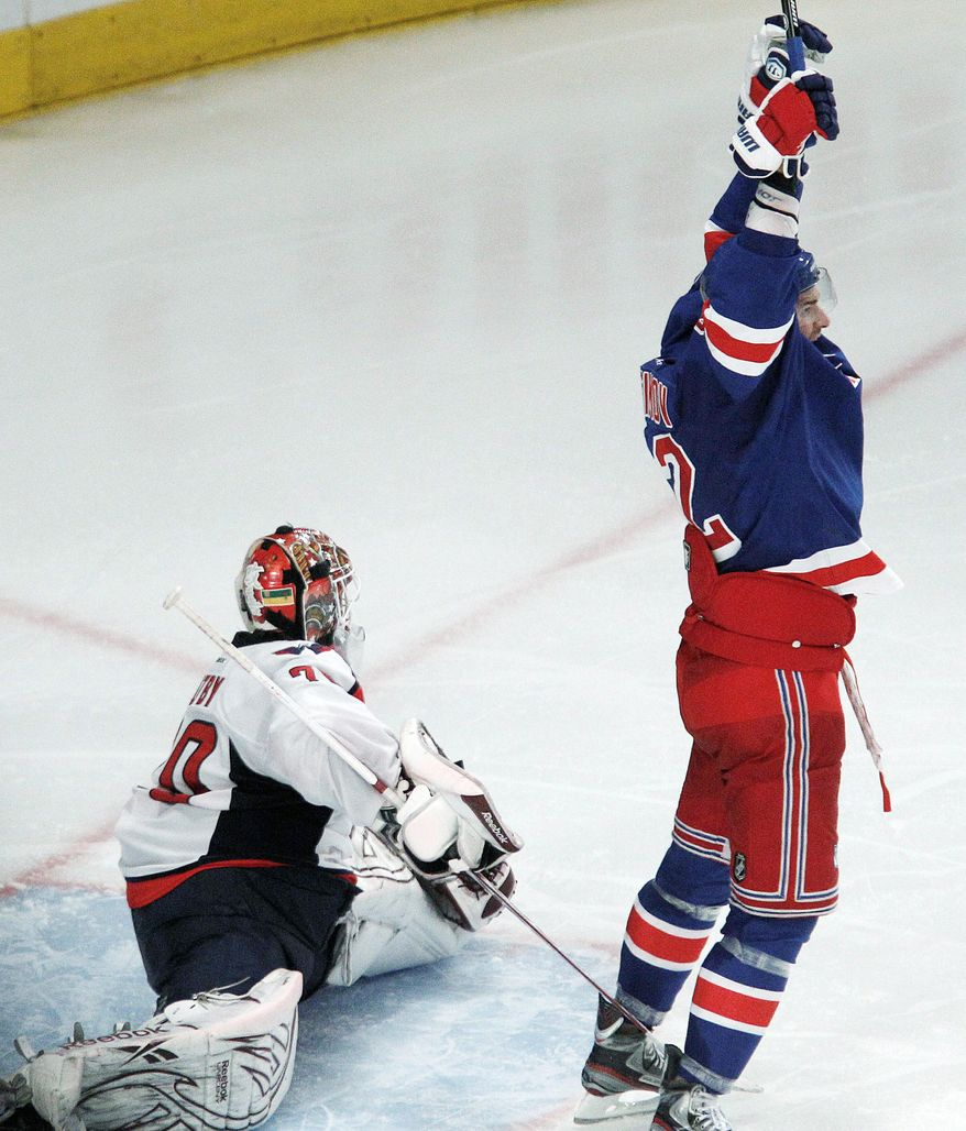 New York Rangers center Artem Anisimov, right, celebrates after Marc Staal's overtime goal slid past Washington Capitals goalie Braden Holtby to give the Rangers a 3-2 victory over in Game 5 of the NHL hockey Stanley Cup Eastern Conference semifinals, at Madison Square Garden in New York, Monday, May 7, 2012. (AP Photo/Kathy Willens)