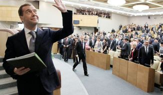 Dmitry Medvedev became Russia's prime minister on Tuesday, a job Vladimir Putin just relinquished. Mr. Putin is again serving as his nation's president. He struck back against critics in parliament irritated by failed policies and slow progress during Mr. Medvedev's four-year term as president. (Ria-Novosti via Associated Press)