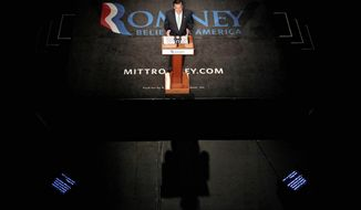 Prospective Republican presidential nominee Mitt Romney campaigns Tuesday in Lansing, Mich. The former Massachusetts governor has tried to reach out to Hispanics with an economic message, arguing that they have lost 300,000 jobs on the Obama administration's watch. (Associated Press)
