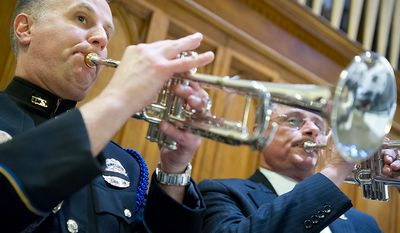 Paul Lindemann, left, with the U.S. Capitol Police and Richard A. Pascuito, a retired U.S. Capitol Police officer, play the trumpet for the annual Blue Mass honoring law enforcement and public safety officials Tuesday, May 8, 2012 at St. Patrick's in the City in Northwest Washington, D.C.  (Barbara L. Salisbury/The Washington Times)