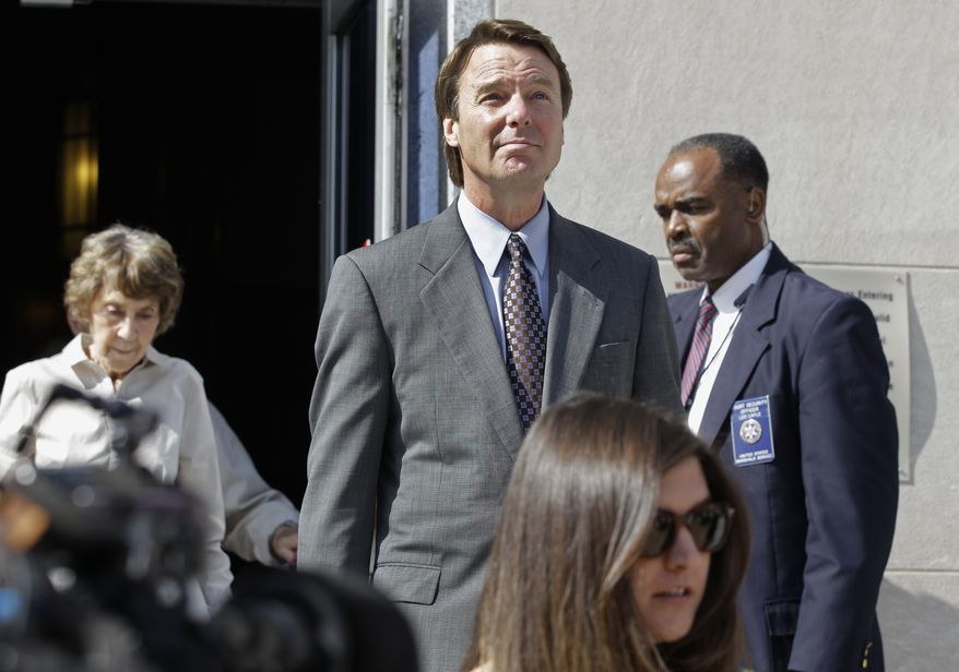 Former presidential candidate and North Carolina Sen. John Edwards (center) leaves a federal courthouse in Greensboro, N.C., on May 7, 2012. Edwards is accused of conspiring to secretly obtain more than $900,000 from two wealthy supporters to hide his extramarital affair with Rielle Hunter and her pregnancy. (Associated Press)