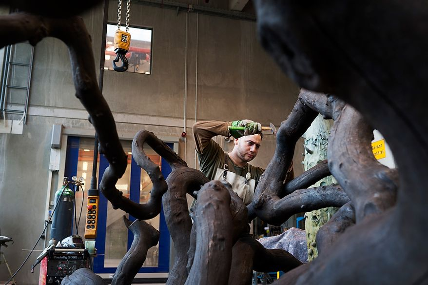 """Mr. Aink, employee at Noack Bronze-casting foundry, is treating the surface of a branch sculpture, which was molded from the beech tree """"Suntel Buche"""", which was located in Bochum, Germany. Thursday, April 26, 2012. Noack is arguably the most important bronze-casting foundry in Germany, based in Berlin. Daniel Pilar/Special to The Washington Times"""