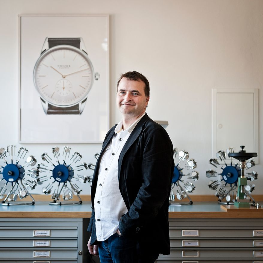 """Portrait of Uwe Ahrendt, CEO of the German watch manufacturer Nomos Glashutte, standing in the final inspection room inside the timepiece manufactory (the so called """"Chronometrie"""") on Thursday, May 26, 2012. Before the watches will be dispatched, they are tested on watch-winders. Christian Burkert/Special to The Washington Times."""