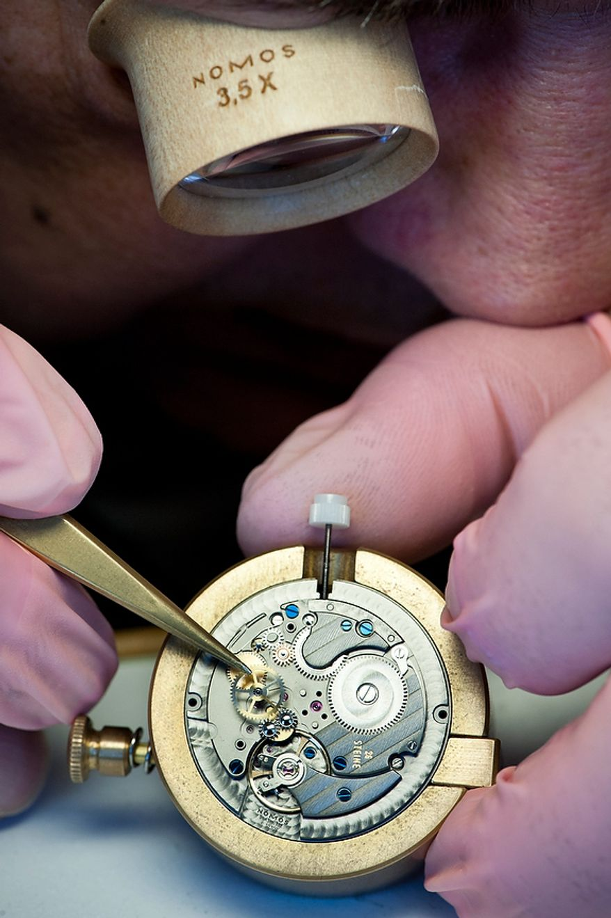 "Details show the craftsmanship: the self-winding movement ""Epsilon"" is assembled by expert watch makers by hand in the timepiece manufactory, the so called ""Chronometrie"", of the enterprise Nomos Glashutte, taken on Thursday, May 26, 2012. Nomos is one of only a few watchmakers worldwide with the designation of manufactory. Christian Burkert/Special to The Washington Times."