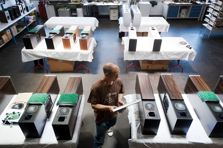 Assembly of tweeters with front grille in the speaker manufactory of Burmester. Emplyee of Burmester is  Burmester Audiosysteme was founded in 1977 and has since been producing top-range high end products in their Berlin manufacture.