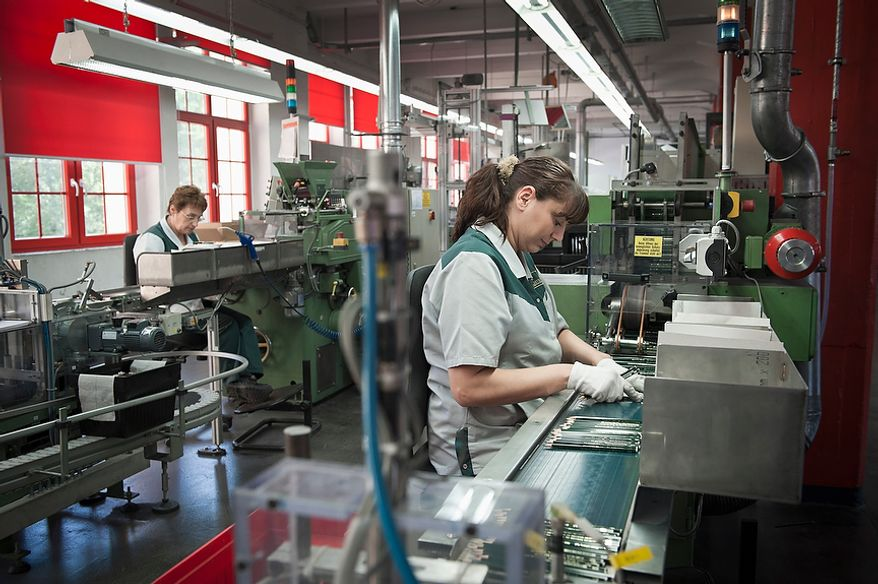 """Faber-Castell employee Leni Lang checks pencils in the final inspection / quality control section in the Faber-Castell pencil manufactory in the city of Stein near Nuremberg on Thursday, May 3, 2012. Faber-Castell is one of the world's largest manufacturers of pens, pencils, other office supplies and art supplies, as well as high-end writing instruments and luxury leather goods. Faber-Castell is know for its """"Perfect Pencil"""", an ordinary lead pencil enclosed in a beautiful silver case that includes a sharpener and can be reused as each pencil wears down. Christian Burkert/Special to The Washington Times."""