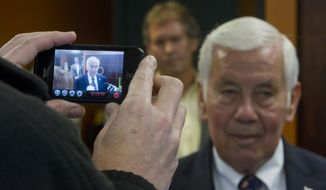 Sen. Richard G. Lugar, Indiana Republican, is video-recorded by cellphone on Monday, May 7, 2012, during a visit to a waste-water treatment center in West Lafayette, Ind. (Associated Press/Journal & Courier)