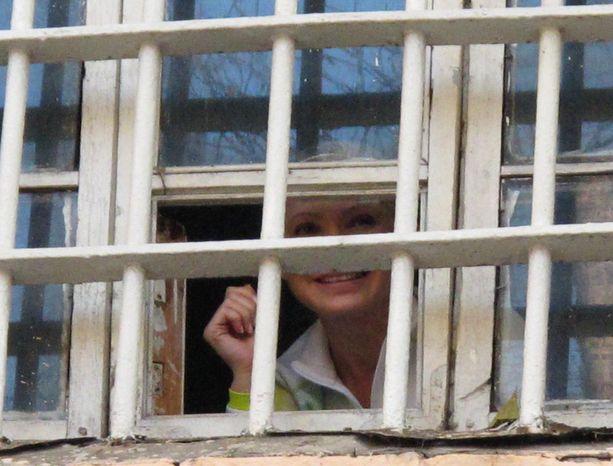 ** FILE ** Former Ukrainian Prime Minister Yulia Tymoshenko looks out from a prison window in Kiev on Friday, Nov. 4, 2011. (AP Photo/Tymoshenko Press Service)