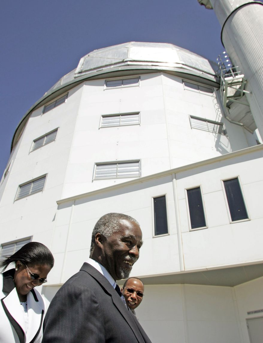 South African Energy Minister Dipuo Peters (left), here with former South African President Thabo Mbeki (center) in 2005, says new nuclear technology is safe. (Associated Press)