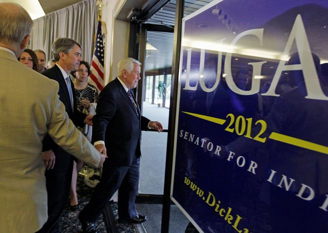 Sen. Richard G. Lugar of Indiana exits after delivering his GOP primary concession speech in Indianapolis on Tuesday night. The 80-year-old Republican was defeated in his bid for a seventh six-year term, to the delight of many tea party activists. (Associated Press)