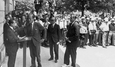ASAlabama Gov. George C. Wallace (left) raises his hand to stop U.S. Deputy Attorney General Nicholas Katzenbach in 1963 as Wallace fails to keep blacks from enrolling at the University of Alabama. Mr. Katzenbach, who played a key role in federal desegregation of the South, died Tuesday. He was 90. (Associated Press)
