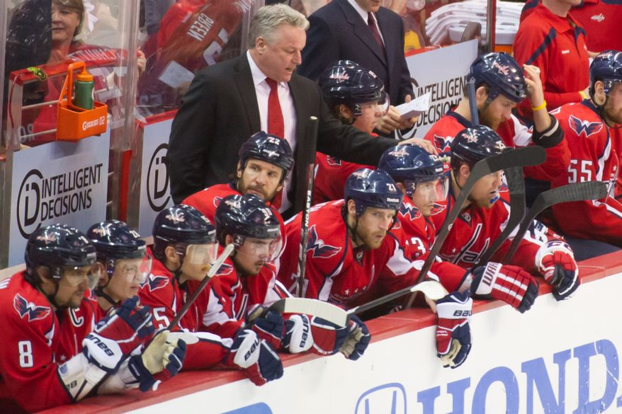 Washington Capitals head coach Dale Hunter talks with his team on the bench before the start of the first period as the Washington Capitals take on the New York Rangers in game six of the NHL eastern conference playoffs semifinals at the Verizon Center, Washington, D.C., Wednesday, May 9, 2012 (Andrew Harnik/The Washington Times)