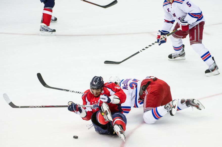 Washington Capitals left wing Alex Ovechkin (8) tries to take a shot on goal after falling on the ice in the third period as the Washington Capitals take on the New York Rangers in game six of the NHL eastern conference playoffs semifinals at the Verizon Center, Washington, D.C., Wednesday, May 9, 2012 (Andrew Harnik/The Washington Times)