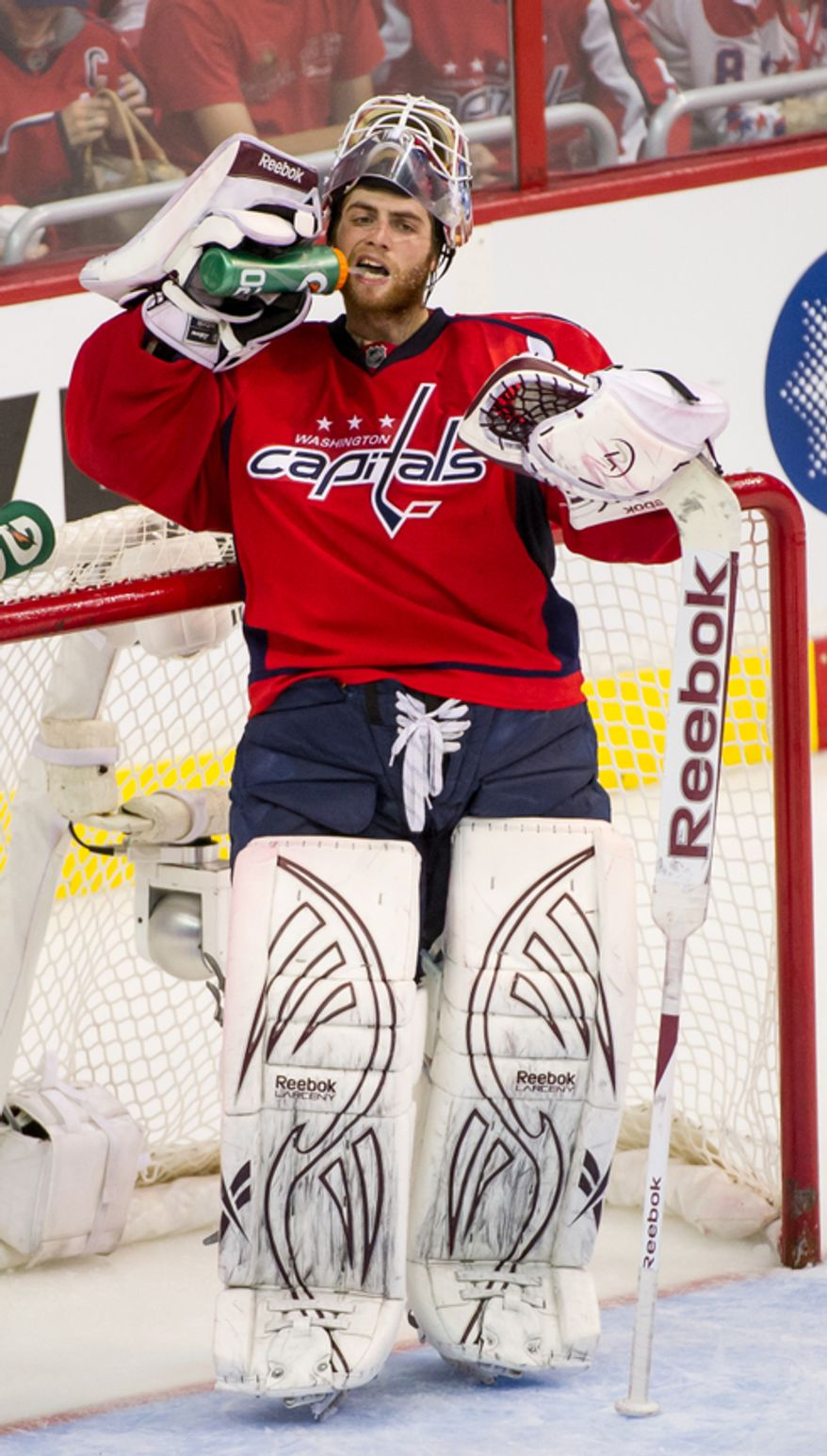 Washington Capitals goalie Braden Holtby (70) drinks water during a break in play in the third period as the Washington Capitals take on the New York Rangers in game six of the NHL eastern conference playoffs semifinals at the Verizon Center, Washington, D.C., Wednesday, May 9, 2012 (Andrew Harnik/The Washington Times)