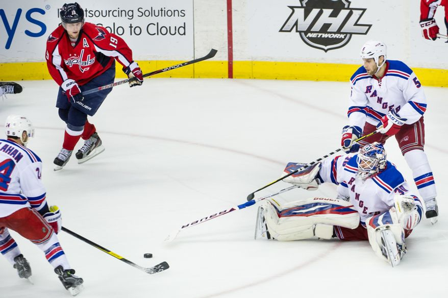 New York Rangers goalie Henrik Lundqvist (30) comes out of the goal while trying to block a shot on goal in the third period as the Washington Capitals take on the New York Rangers in game six of the NHL eastern conference playoffs semifinals at the Verizon Center, Washington, D.C., Wednesday, May 9, 2012 (Andrew Harnik/The Washington Times)
