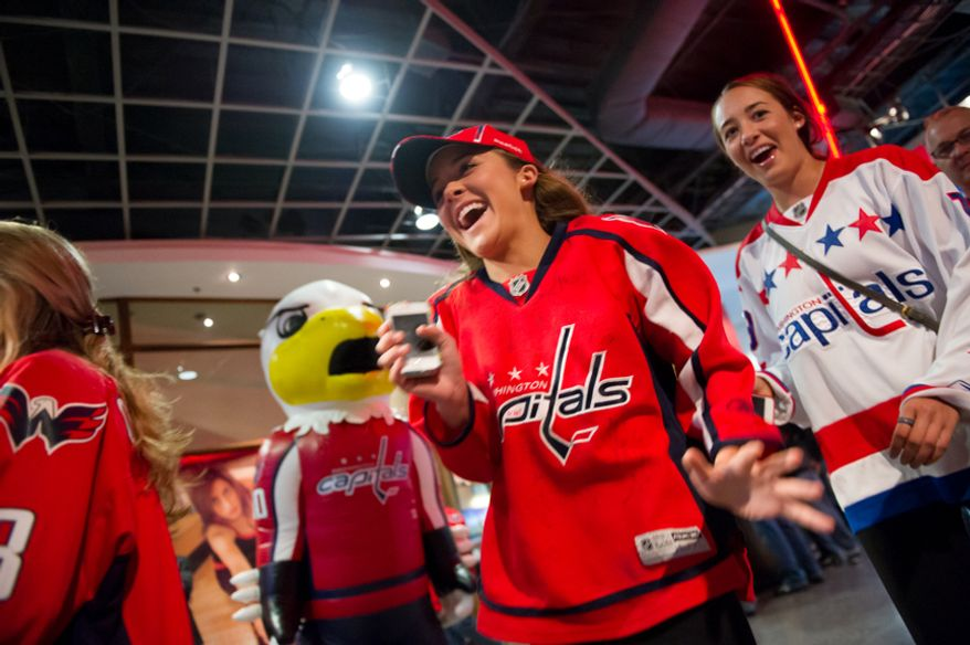 "Grayson McPhe, center, of Bethesda, Md., screams as the Washington Capitals mascot ""Air Slapshot,"" left, scares her and other fans in the hallways of the Verizon Center before the Washington Capitals take on the New York Rangers in game six of the NHL eastern conference playoffs semifinals, Washington, D.C., Wednesday, May 9, 2012 (Andrew Harnik/The Washington Times)"