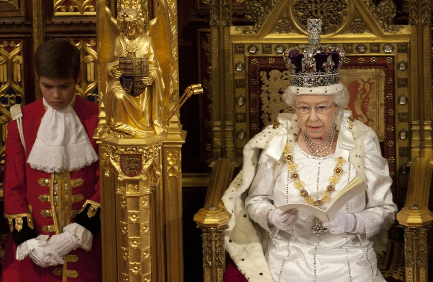 Britain's Queen Elizabeth II reads the Queen's Speech, outlining the government's legislative agenda, to lawmakers in the House of Lords in London on Wednesday, May 9, 2012. (AP Photo/Alastair Grant, Pool)