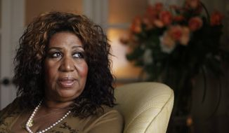 ** FILE ** In a July 26, 2010, file photo, performer Aretha Franklin looks out a window, in Philadelphia. Aretha Franklin is one of six people who will be inducted into the Gospel Music Hall of Fame on Aug. 14, 2012, in Hendersonville, Tenn. (AP Photo/Matt Rourke/file)