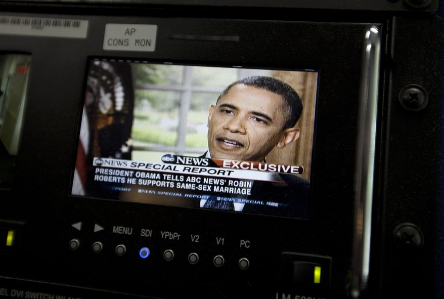 President Obama is pictured on a monitor in the White House briefing room in Washington on Wednesday, May 9, 2012, during an interview with ABC News in which he said he supports gay marriage. (AP Photo/Carolyn Kaster)