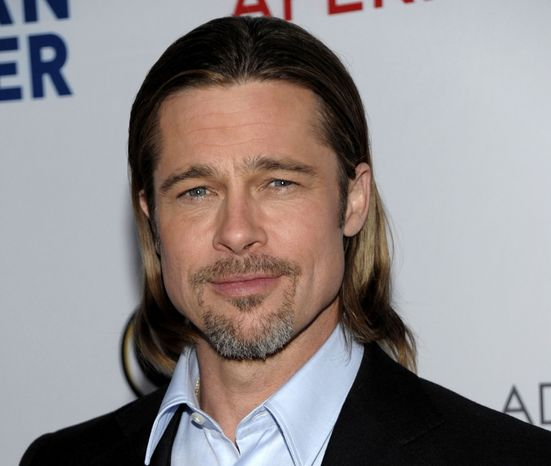 """** FILE ** In this March 3, 2012, file photo, actor Brad Pitt arrives at the Los Angeles premiere of the play """"8"""" in Los Angeles. Chanel announced Wednesday, May 9, that Pitt will star in an upcoming ad campaign for its signature women's scent. (AP Photo/Dan Steinberg, file)"""
