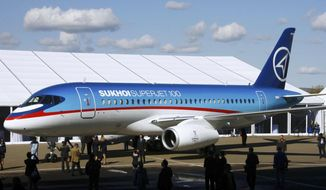 ** FILE ** The Sukhoi Superjet-100 is displayed outside the aviation factory in Komsomolsk-on-Amur, about 6200 kilometers (3,900 miles) east of Moscow, Russia's, in this Sept. 26. 2007, file photo. An official says air controllers have lost contact with the Russian-made plane similar to this one shown May 9, 2012, carrying 46 people in western Indonesia. (AP Photo/RIA-Novosti, Ruslan Krivobok, File)