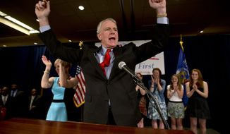 Milwaukee Mayor Tom Barrett celebrates after speaking at his Democratic gubernatorial primary election victory party on Tuesday, May 8, 2012, in Milwaukee. Mr. Barrett will face Republican Gov. Scott Walker in a June recall election. (AP Photo/Morry Gash)
